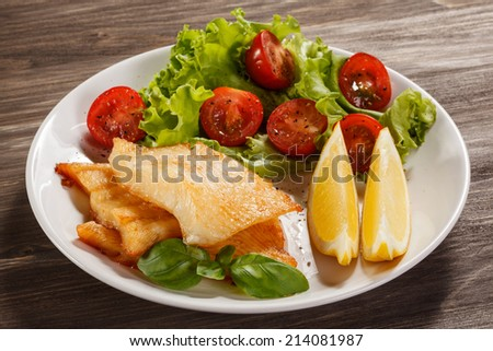 Fish dish - fried fish fillet, with vegetables - stock photo