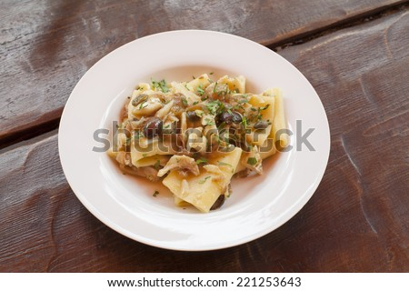 Fish dish - pasta whit fish fillet and vegetables - stock photo