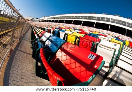 Fish eye composition of vibrant stadium seating - stock photo