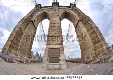 fish-eye lens photo of Brooklyn Bridge pylon in New York City - stock photo