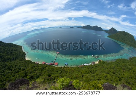 Fish eye panoramic view of Tun Sakaran Marine Park tropical island in Semporna,  Sabah, Malaysia. Taken from Bohey Dulang Island. - stock photo