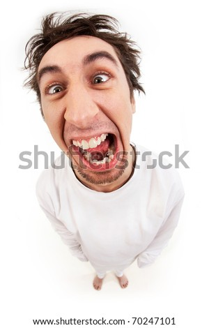 Fish eye shot of screaming insane man in strait-jacket in isolation - stock photo