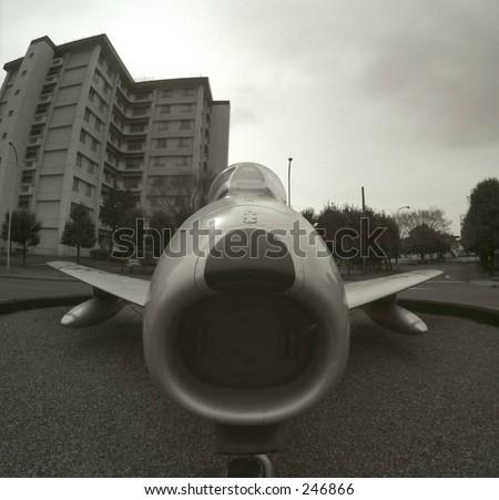 "Fish eye view of F86 Sabre fighter jet ""Nina"", on display at Yokota Air Base, outside of Tokyo, Japan.  This jet was flown in combat during the Korean War. - stock photo"