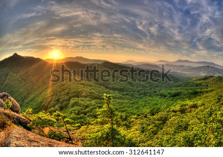 Fish-eye view of majestic sunset of the Russian Primorye mountains landscape HDR image  - stock photo