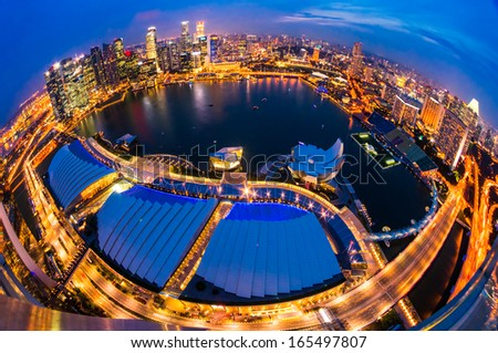 Fish-eye view of Singapore city skyline at sunset.  - stock photo