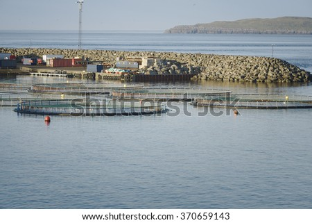Fish farm in northern Norway - stock photo