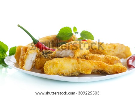 Fish fried in batter on a white background - stock photo