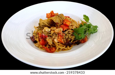 Fish fried spaghetti on white plate on black background - stock photo