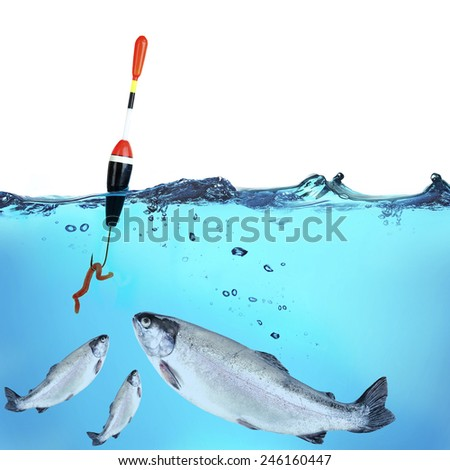 Fish hook with worm in water - stock photo