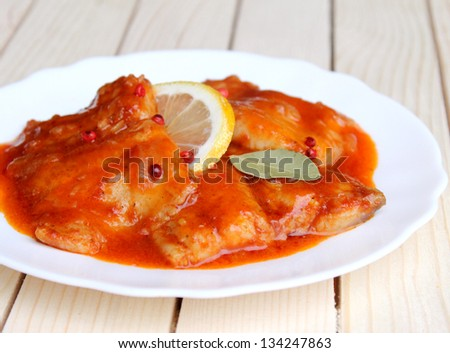 Fish in Tomato Sauce - stock photo