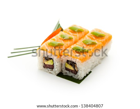 Fish Maki Sushi - Roll with Tuna, Eel and Avocado inside. Topped with Salmon and Lettuce - stock photo