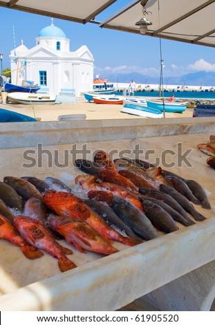 Fish market on the island of Mykonos... - stock photo