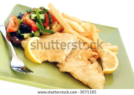 Fish 'n' chips, with Greek salad. - stock photo