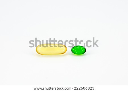 Fish oil and vitamin E capsules isolated on white background - stock photo