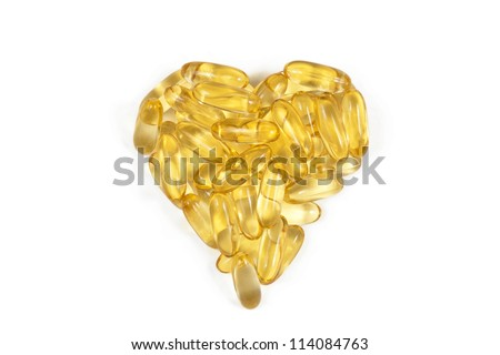 Fish oil capsules arranged in heart shape - stock photo
