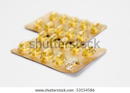 Fish oil capsules on a white background - stock photo
