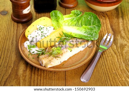Fish, potato with cottage cheese, salad and fork, close up - stock photo