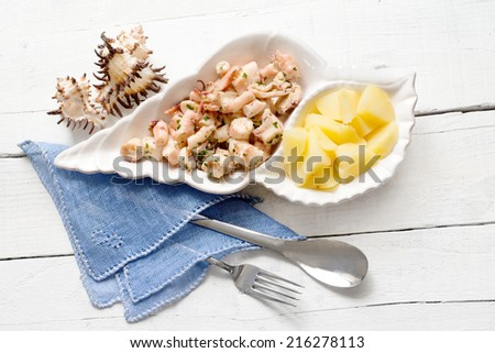 fish recipe with  octopus and boiled potatoes - stock photo