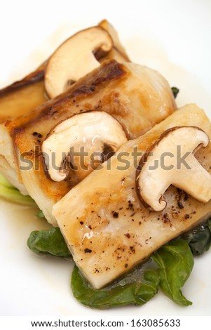 Fish sauce and mushrooms. - stock photo