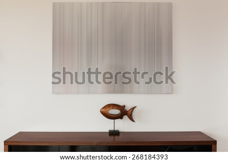 Fish shaped decor on the table top - stock photo