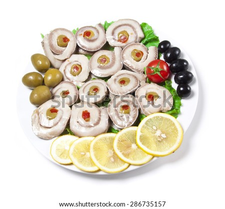 fish slices served with tomato and olives - stock photo