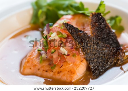 fish soup in white plate. selective focus - stock photo