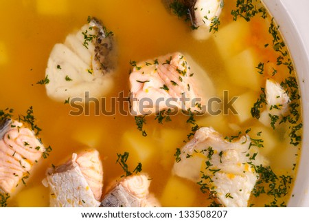 Fish soup with salmon, escolar, pikeperch - stock photo