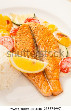 fish steak wit rice and vegetables - stock photo