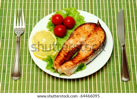 Fish Steak with vegetables - stock photo