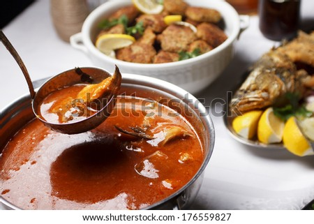 Fish stew on served restaraunt table - stock photo