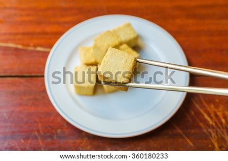 fish Tofu in the plate on a wooden table - stock photo