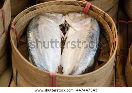 Fish tuna 2 pieces are in fish baskets which made from bamboo . - stock photo