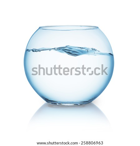 fishbowl with wavy water surface - stock photo