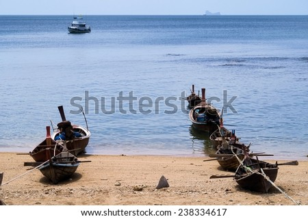 Fisher boats lined up on the beach - stock photo