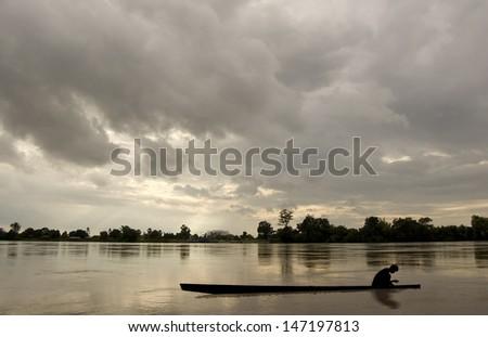 Fisherman. Boat at the Dusk  - stock photo