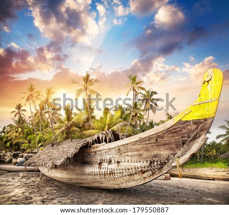 Fisherman boat on the beach at sunset sky in India   - stock photo
