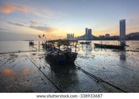 Fisherman boat view during sunrise of Tanjung Bungah in Penang, Malaysia - stock photo