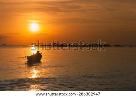 Fisherman boat with sunset scene in koh phangan, Surat Thani, Thailand - stock photo