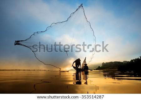 Fisherman casting his net at the sunset at Mae Klong River, Thailand - stock photo