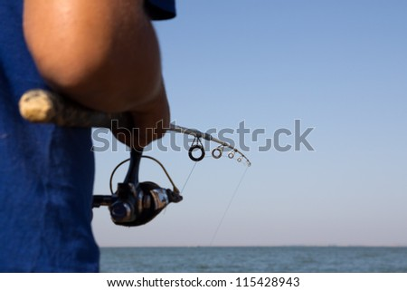 fisherman catches a fish on a spinning - stock photo