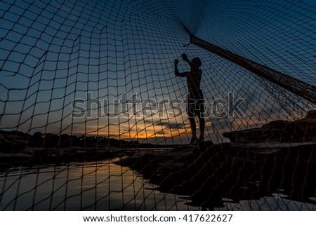 fisherman in the dark - stock photo