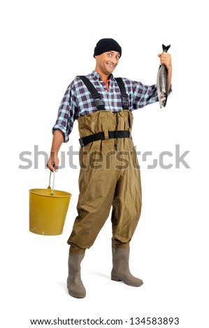 Fisherman posing with the catch isolated in white - stock photo