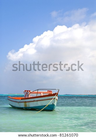 Fisherman's boat in a tranquil bay outside of Oranjestad Aruba of the Netherlands - stock photo