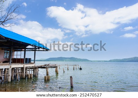 Fisherman's house settled in the sea with blue sky - stock photo
