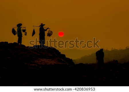 fisherman silhouette at the river. - stock photo