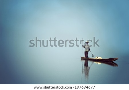 Fisherman, Stand Alone Fisherman on a still lake from the boat,  Feeling peaceful, quiet, composed, undisturbed. Process in Art Style. - stock photo
