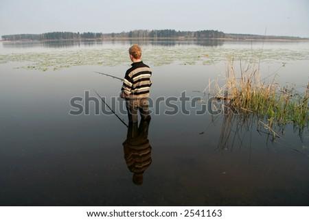Fisherman, summer, travel - stock photo