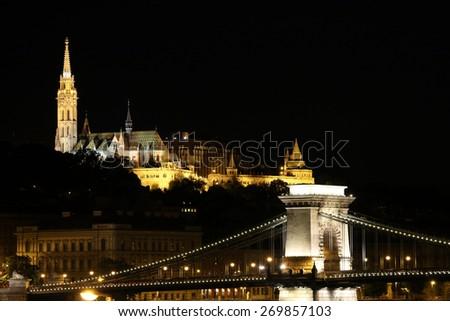 Fisherman towers and Chain bridge by night Budapest Hungary - stock photo