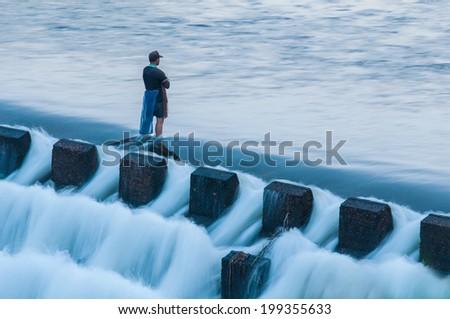 Fisherman waiting for catching - stock photo