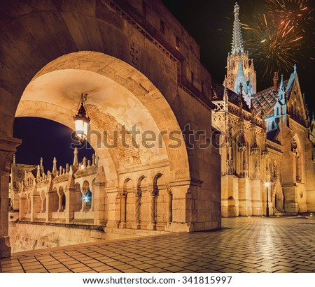 Fishermans Bastion and Matthias church in Budapest, Hungary, with fireworks in the evening sky - stock photo